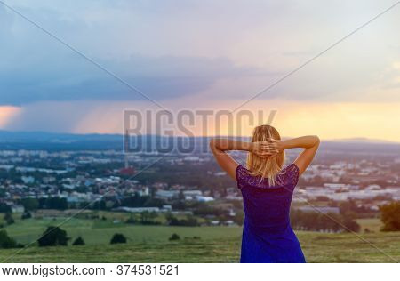 Beauty Blonde Hair Woman Standing With Hand On Head And Looking To City Ceske Budejovice At Sunset W