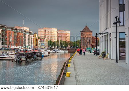 Gdansk, Poland - June 20, 2020: Modern architecture of the granaries island in old town of Gdansk at sunset.