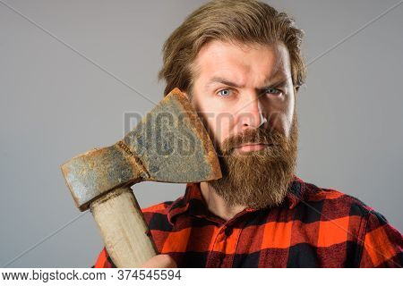 Man With Old Ax. Bearded Lumberjack. Close Up Portrait Of Man With Ax. Canadian Lumberjack. Bearded