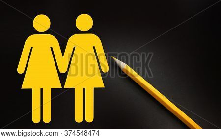Two Female Icons In Yellow On Black. Woman And Woman Couple Sign, Lgbt Concept