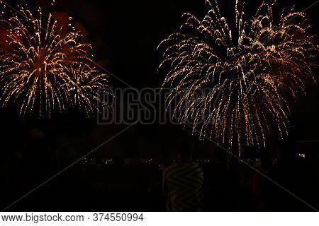 People Watch The Fireworks. Fourth Of July Fireworks. Fireworks Light Up The Sky With Dazzling Displ