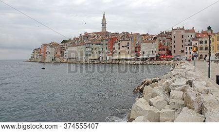 Rovinj, Croatia - October 15, 2014: Old Town Cityscape And Breakwater Stones Sea Wall Pier In Rovinj