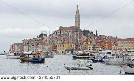 Rovinj, Croatia - October 15, 2014: Boats At Harbour And Old Picturesque Town In Rovinj, Croatia.