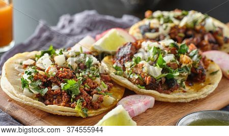 mexican street tacos with carne asada on corn tortillas platter