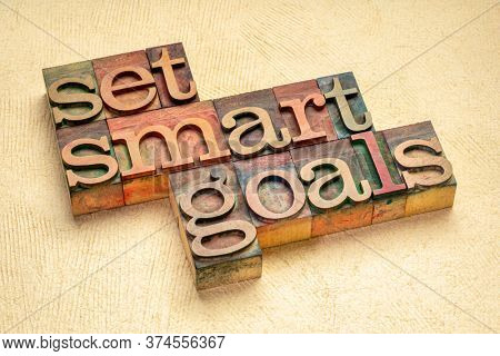 set SMART goals  - word abstract  in vintage letterpress wood type stained by color inks, goal setting, planning, business and personal development concept