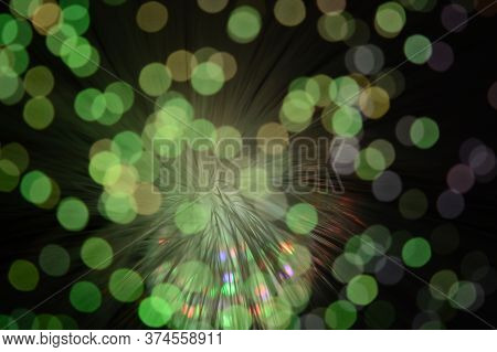 A Bokeh Focused Image Of Some Fiber Optic Cables With Lights Shining Through Them.