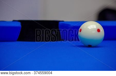 Background Image Of Billiard Balls In A Blue Pool Table.