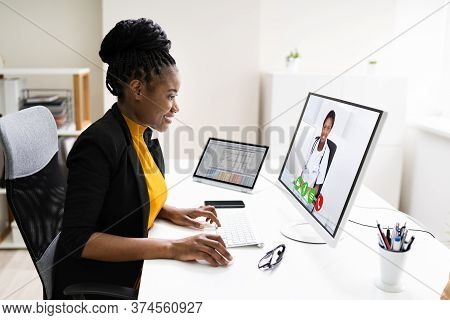 Woman Having Video Conference Web Call With Doctor