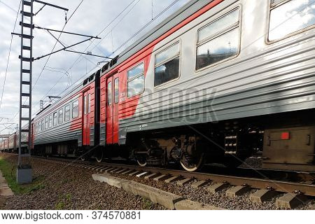 Moscow 02/06/2019 Gray And Red Electric Train Passing By, Side View, Closeup, Perspective Lines, Rai