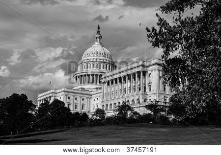 Washington DC, United States Capitol Building in autumn in  very dramatic clouds - Black and white