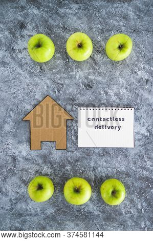 The New Normal After Covid-19, Contactless Delivery Text On Notepad Among Apples And With House Icon