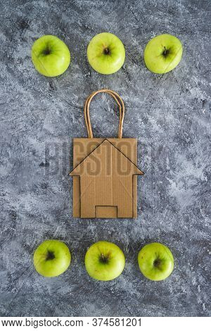 Home Delivery And Groceries Shopping Concept, Shopping Bagwith House Icon Among Apples Symbol Of Hea
