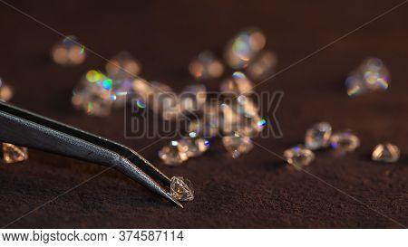 Diamond With Tweezers And Magnifier.gemstone Beauty,jewel, Diamond