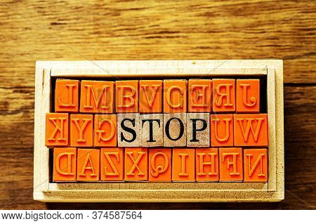 Atop - Isolated Abstract In Wood Type Stamps Against Wooden Background And Copy Space.close Up.