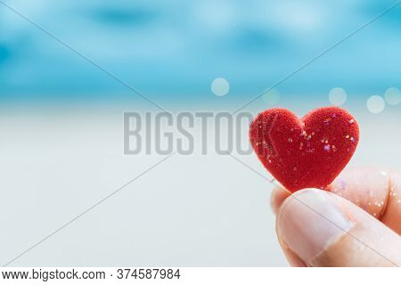 Hand Hold Little Heart Meaning Feel Love With Summer Beach With Blue Sky Background.