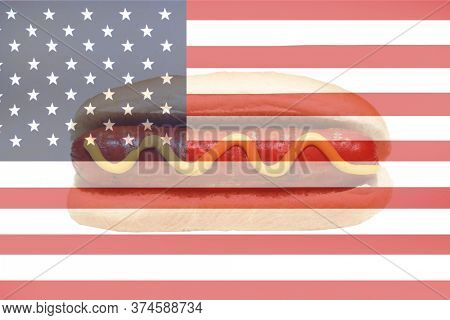 4th of July. American Flag with 4th of July Hot Dog with Mustard. American Independence Day Celebration.  Happy Forth Of July. Room for text overlay.