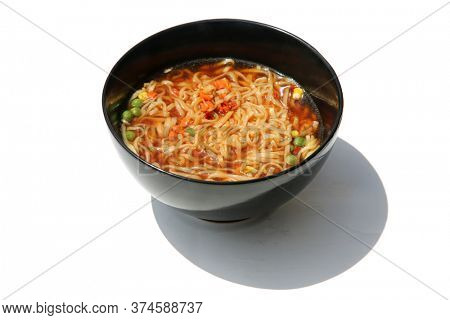 Teriyaki Beef Noodle Soup with Vegetables. Beef Noodle Soup in a Black Ceramic Bowl. Isolated on white. Room for text. Soup is enjoyed world wide for Lunch or Dinner.