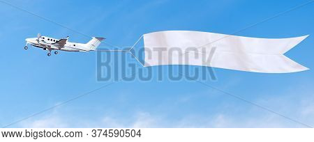 Plane Flies In The Sky With A White Banner For Ad.
