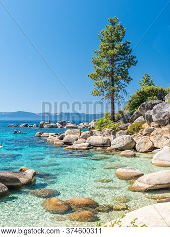North Shore Of Lake Tahoe Secret Harbor With Giant Granite Boulders In Clear Blue Turquoise Water On