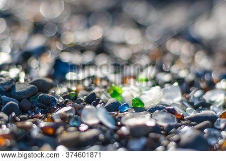 Illuminated Sea Glass On Beach In Fort Bragg Mendocino County California. Former Dump Turned Treasur