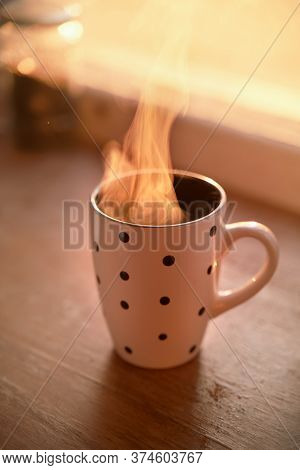 Hot Drink In Mug And Vintage Window Sill. Hot Beverage Steaming In Sun Sun Rays. Polka Dot Cup With