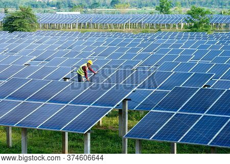 Engineer Working And Checking At Solar Power Station,climate Change And Renewable Energy,renewable E