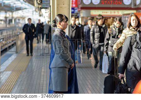 Osaka / Japan - December 20, 2017: Female Train Attendant Standing At Shin-osaka Railway Station, Wh