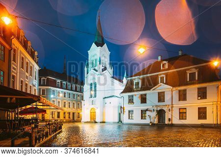 Riga, Latvia - July 3, 2016: White Tower With Pyramidal Spire Of Our Lady Of Sorrows Or Virgin Of An