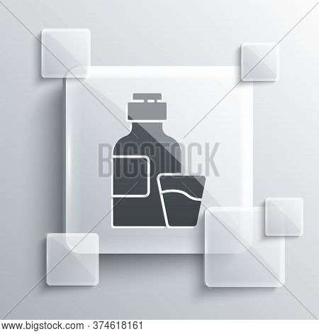 Grey Bottle Of Medicine Syrup And Dose Measuring Cup Solid Icon Isolated On Grey Background. Square