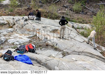 Sudbury, Ontario, Canada - May 23 2009: Group Of Workers And Geologists Standing And Working On Geol