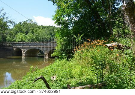 Aqueduct Bridge And River Water And Plants