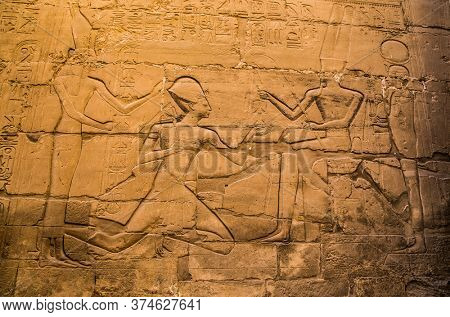 Luxor, Egypt - Jan 28, 2020: The hieroglyphics at wall of Luxor Temple in Luxor, ancient Thebes, Egypt. Luxor Temple is a large Ancient Egyptian temple complex locatedon the east bank of the Nile
