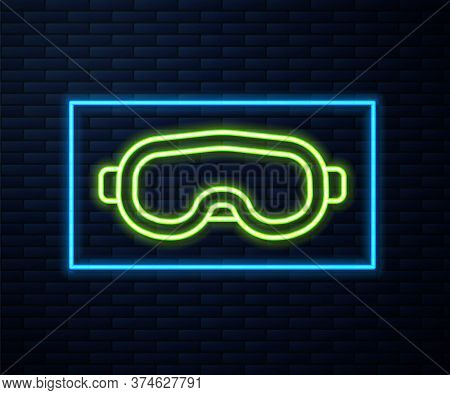 Glowing Neon Line Ski Goggles Icon Isolated On Brick Wall Background. Extreme Sport. Sport Equipment