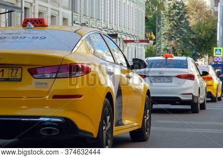 28/08/2019 Moscow City Traffic Jam, Many Yellow Cabs In A Row, Back View.