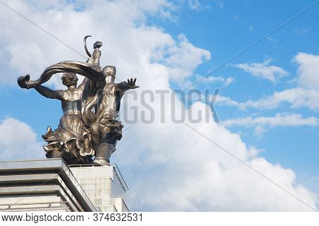 Moscow 26/05/2019 Back View Of Worker And Kolkhoz Woman Sculpture. Man And Woman Made Of Steel With