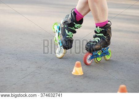 Roller Skater Legs In Motion, Inline Roller Skating, Rollerblading, Slalom On Asphalt Surface. Small