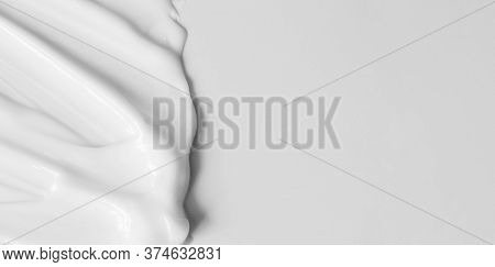 Close-up Cream Moisturiser Smear Smudge Wavy Texture On White Background With Copy Space Horizontal