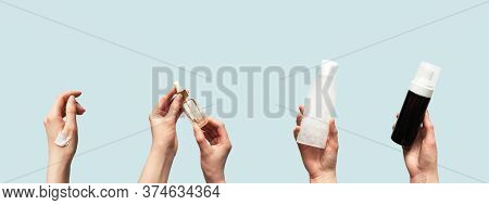 Hands Up Holding Beauty Cosmetic Products Isolated On Blue Background Horizontal Banner Format. Woma