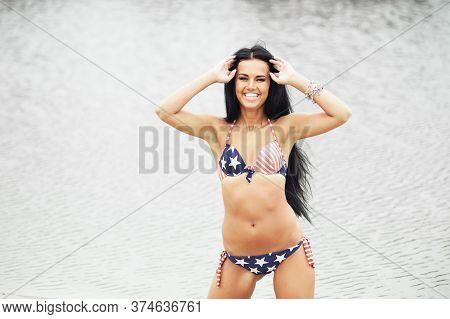 Beautiful Woman In Swimwear Walking Along Seaside
