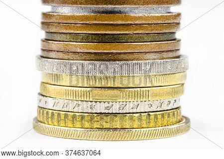 A Macro Shot Of A Stack Of Coins Stacked In A Bar, Isolated On A White Background, With Space For Te