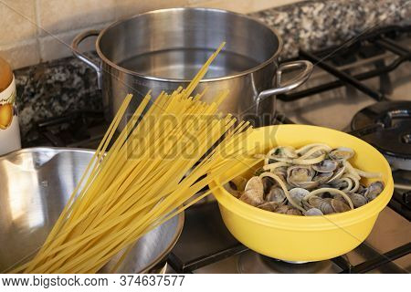 Preparing Spaghetti With Clams On A Hob At Home