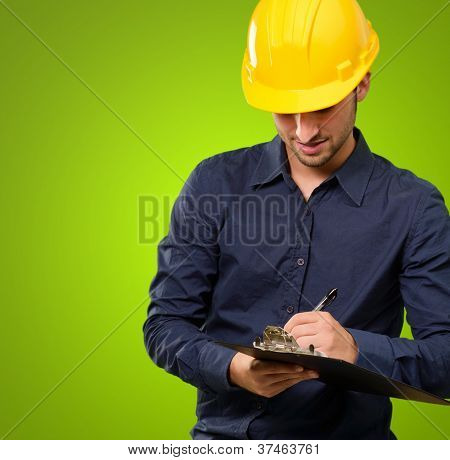 Architect Writing On Clipboard Isolated On Green Background