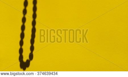 Japa Beads Shadows On Yellow Pastel Paper. Abstract Backgorund. Stock Photo.