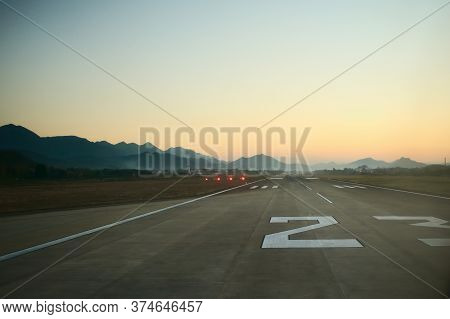 Airport Runway At Dawn. Travel, Air Transport, Aeronautical Industry Concept.