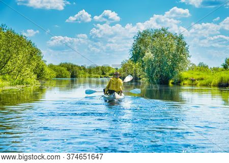Couple At Kayak Trip On Blue River