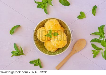 Yellow Watermelon Sorbet  Ice Cream With Mint Leaves. Top View