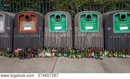 Overflowing, Green and Brown Bottle Recycling Bins - Ireland