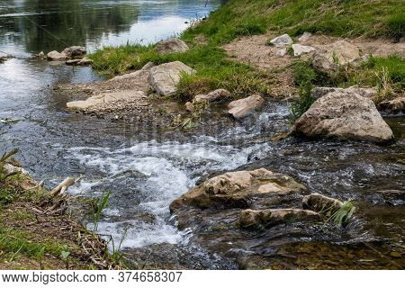 Detail Of The Water Flow In A Small River, Before It Joins The Main River Vah. Natural Stones And Gr