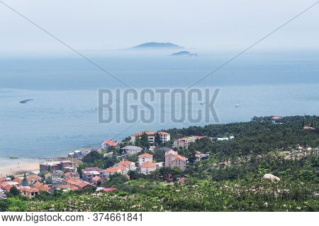 Beach Homes On The East China Sea Near Laoshan In Qingdao China On A Hazy Day In Shandong Province.