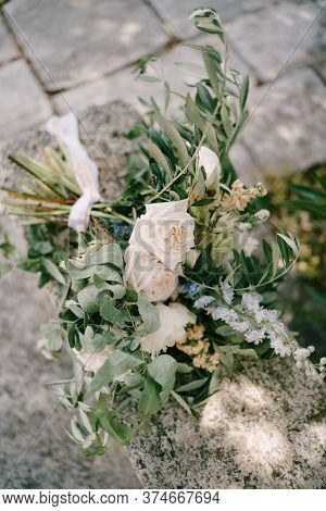 Bridal Bouquet Of White And Cream Peonies, Roses, Veronica, Delphinium, Branches Of Eucalyptus Tree